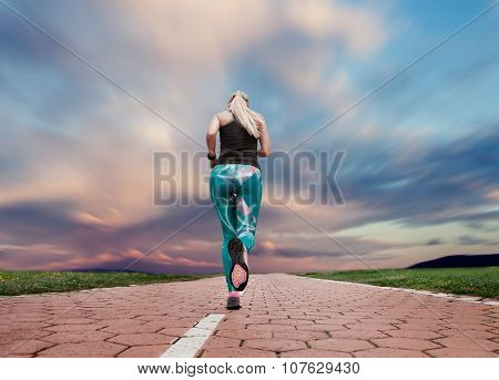 Young Blonde Girl Evening Jogging With Great Cloudscape