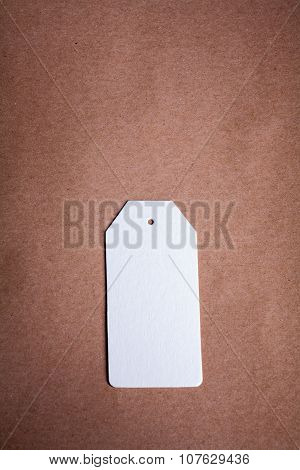 White Paper label on a brown craft paper background