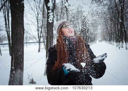 Beauty Winter Girl Blowing Snow In Frosty Winter Park