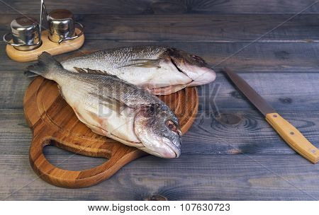 N A Wooden Table Cutting Board With Fresh Raw Dorado Fish Gutted