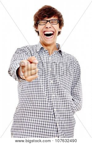 Young hispanic man wearing blue checkered shirt and black glasses pointing at camera with his index finger and laughing out loud isolated on white background - humor concept