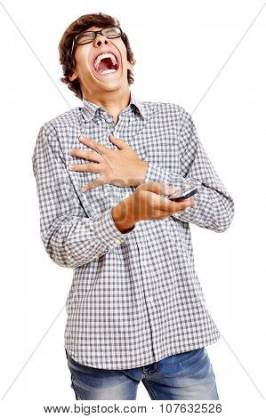 Young hispanic man wearing blue checkered shirt and black glasses holding mobile phone in his hand and laughing out loud isolated on white background - humor and communication concept