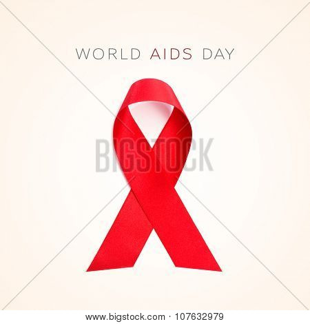 text World AIDS Day and a red ribbon on a beige background