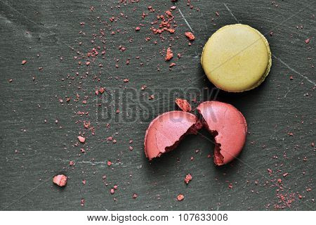 some appetizing macarons of different flavors on a slate surface