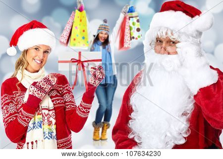 Happy woman with envelope and Santa Claus. Christmas shopping.