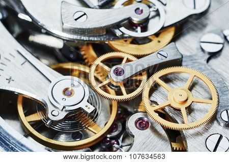 Time concept. clock mechanism close-up view. Shallow DOF.