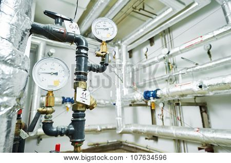manometers and valves with heating pipelines in boiler room