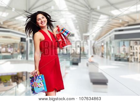 Beautiful woman with shopping bags. Isolated on white background.