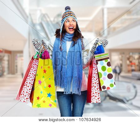 Shopping woman with a bags in shopping mall.