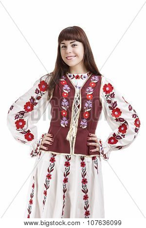 Portrait Of Smiling Brunette Lady Posing In National Flowery Costume. Isolated Over White Background