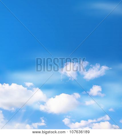 White Clouds In The Sky On Blue