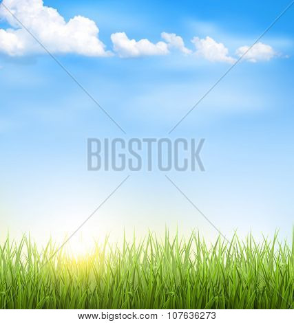 Grass Lawn With Clouds And Sun On Blue Sky