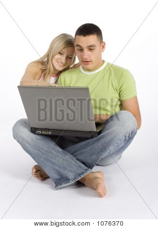 Surprised Young Couple With Laptop