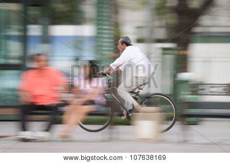 Panning shot on unknown biker in motion blur