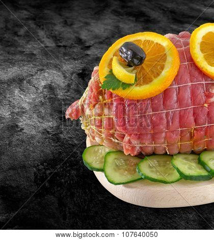 Rolled Fresh Ham Meat In Tied - Veal Roulade. Raw Rolled Meat Enclosed In Net Netting With Spices -