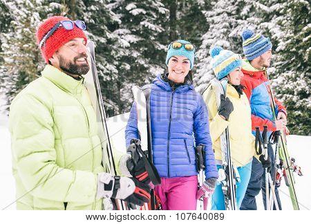 Happy Friends Having Fun On The Snow