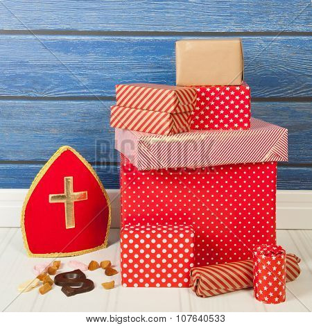 Dutch Sinterklaas gifts and candy on blue background
