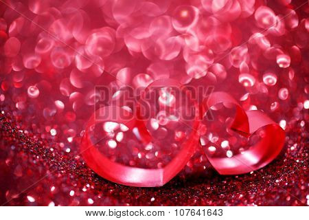 Red ribbon hearts on glitter background, Valentines day concept