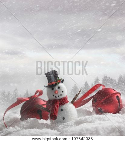 Snowman with bells in snowy winter background
