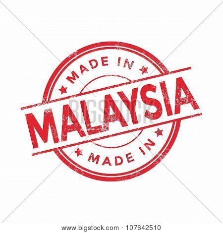 Made in Malaysia red vector graphic. Round rubber stamp isolated on white background.