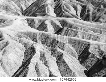 Badlands of the Death Valley National Park seen from Zabriskie Point. California, USA. Monochrome