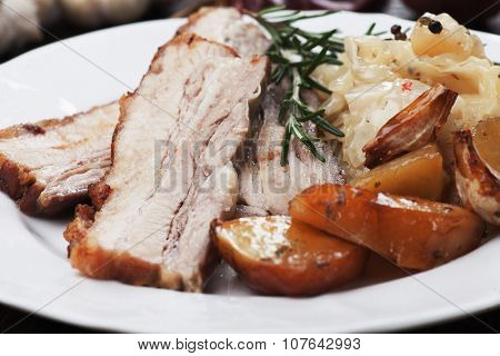 Roasted pork belly or bacon with potato and sauerkraut