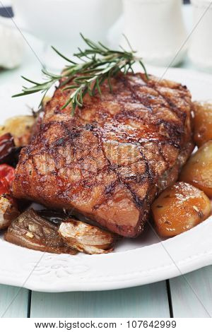 Roasted pork belly or bacon with spicy potato and rosemary