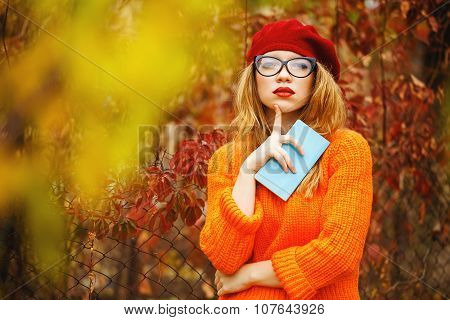 Lovely Girl In Beret And Sweater In Autumn Park, Holding Notebook.