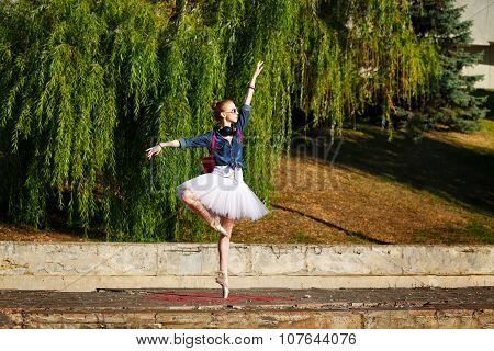 Ballerina Dancing Hipster On The Street.