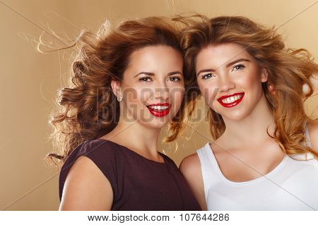 Portrait Of Two Girls With Clean Skin. Professional Makeup And Hair Style.