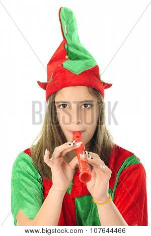 Close-up of a pretty teen Christmas elf playing a red recorder.  On a white background.
