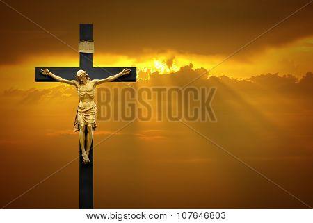 Jesus Christ On The Cross Over Sunrise Background