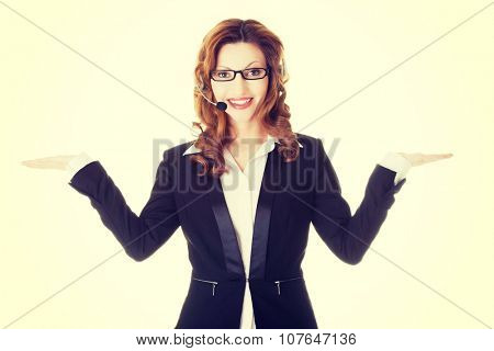 Call center assistant advertising copy space on her palm.