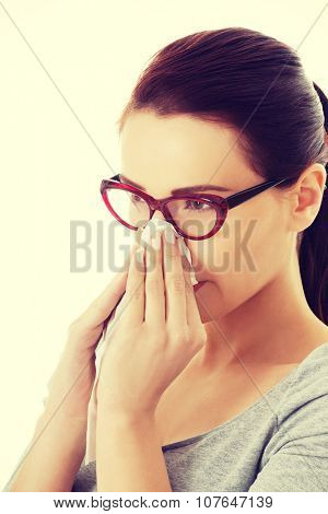 Casual beautiful woman in eyeglasses with tissue