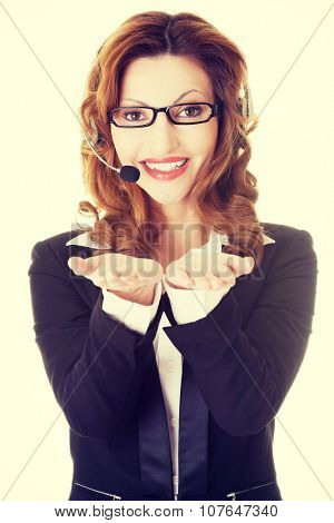 Call center assistant advertising copy space on her palm
