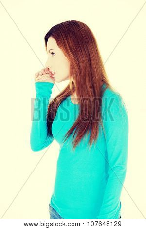 Beautiful casual woman talking gossip.