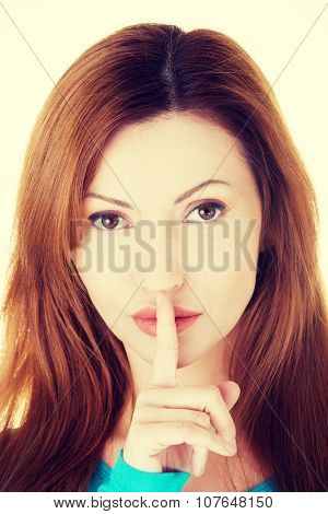 Hush be quiet woman isolated. Woman with finger on her lips.
