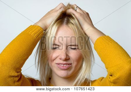 Disgusted Young Woman Scratching Her Head