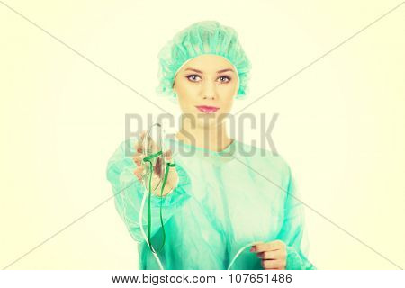 Female doctor holding oxygen mask to put on patient.