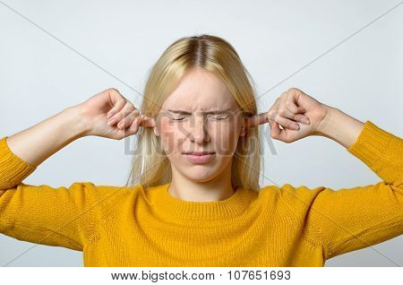 Disgusted Woman Covering Her Ears With Fingers