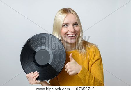 Happy Young Woman Holding Vinyl Record