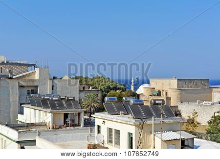 Solar Water Heating Systems On The House's Roofs