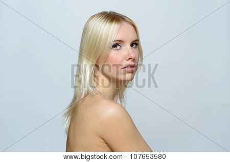 Shirtless Blond Young Woman Looking At The Camera