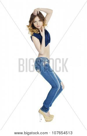 Portrait in full growth the young blonde woman in blue jeans, isolated on white background