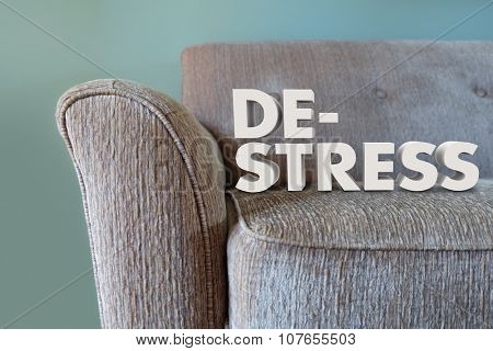 De-Stress words in 3d letters on a couch to illustrate unwiding mind, body and soul to relax