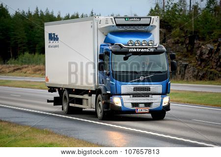 Blue Volvo FE Reefer Truck On Motorway