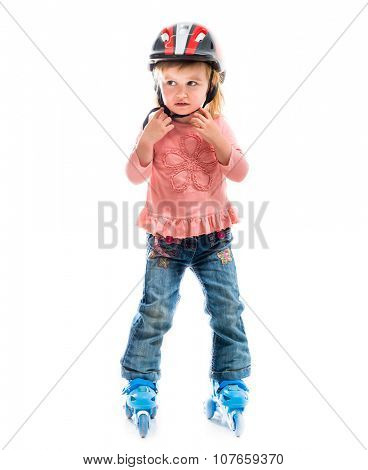 little preschool girl on rollerskates isolated on white background
