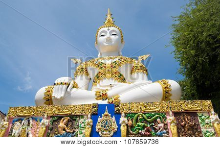 Gold Statues With Colourfull Temple In Background Asia