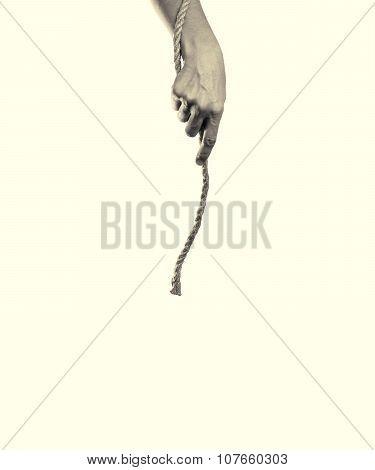 woman's hand holds a rope