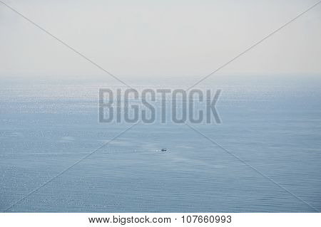 fishery boat floating on the vast sea